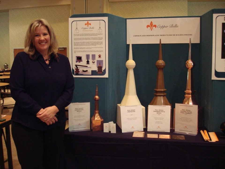 Photo - Copper Bella owner Teri Ward at her company's exhibit during the Wes Watkins New Product and Process Fair. The Sand Springs start-up won first place overall at the event for inventors and aspiring entrepreneurs.