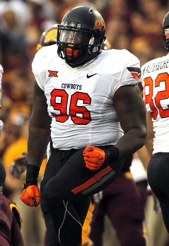 Photo - Oklahoma State's Vincent Taylor (96) celebrates a defensive tackle during the college football game between the Central Michigan Chippewas and the Oklahoma State University Cowboys at the Kelly/Shorts Stadium in Mount Pleasant, Mich., Thursday, Sept. 3, 2015. Photo by Sarah Phipps, The Oklahoman