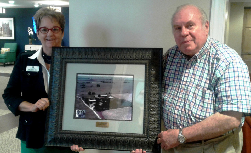 Photo - Anita Kelley and Larry Griffin show off a picture of the Griffin farm. Photo provided.