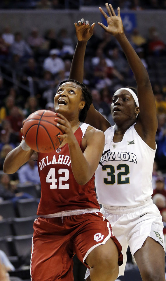 Photo - Oklahoma's Kaylon Williams (42) tries to score in front of Baylor's Beatrice Mompremier (32) during a semifinal game in the Big 12 Women's Basketball Championship between the Oklahoma Sooners (OU) and the Baylor Lady Bears at Chesapeake Energy Arena in Oklahoma City, Sunday, March 6, 2016. Photo by Nate Billings, The Oklahoman