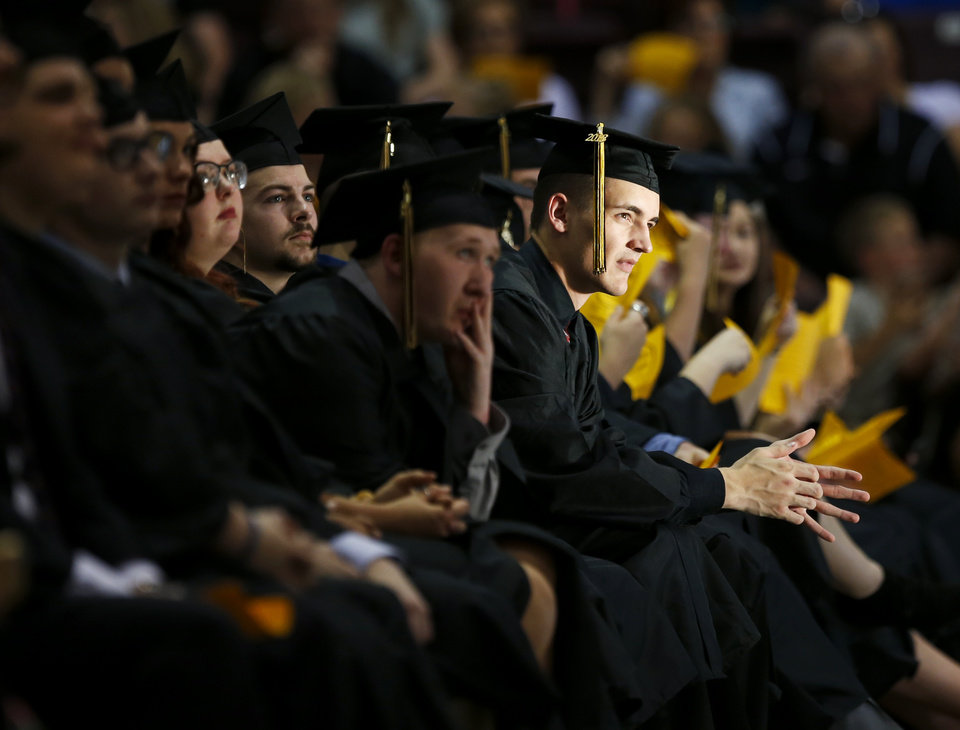 Photo -  McAlester High School graduating seniors listen to former Gov. George Nigh's commencement address Friday.
