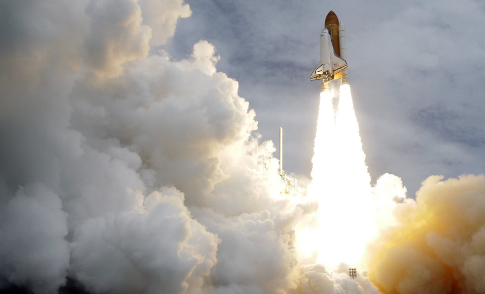 Photo -  FILE - In this Friday, July 8, 2011 file photo, the space shuttle Atlantis lifts off from the Kennedy Space Center in Cape Canaveral, Fla. Atlantis was the 135th and last space shuttle launch for NASA. (AP Photo/John Raoux)