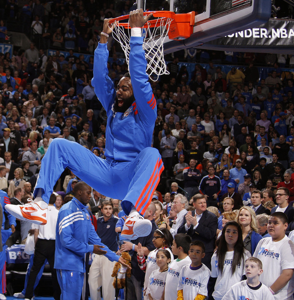 Photo - Oklahoma City's James Harden (13) hangs on the rim before an NBA basketball game between the Oklahoma City Thunder and the Los Angeles Lakers at Chesapeake Energy Arena in Oklahoma City, Thursday, Feb. 23, 2012. Photo by Bryan Terry, The Oklahoman