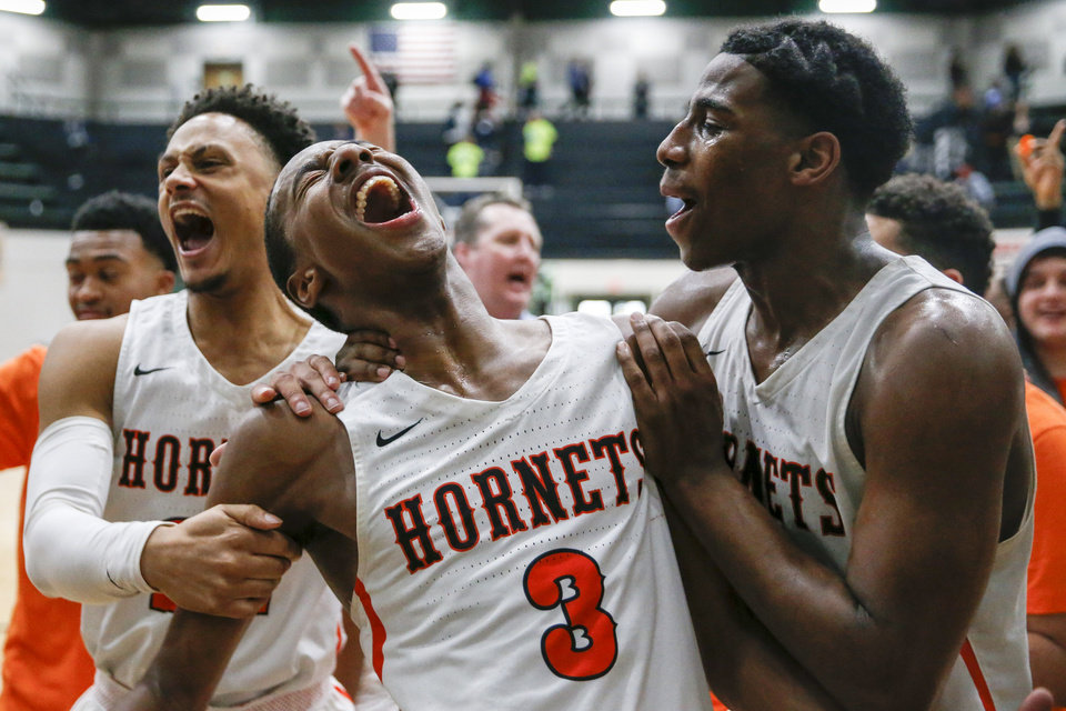 Photo - Booker T. Washington's Bryce Thompson yells in celebration with teammates Michael McHenry and Seth Hurd sing their school's song after their OSSAA quarterfinal win over Putnam City West and Booker T. Washington at Catoosa High School on Thursday, March 7, 2019. IAN MAULE/Tulsa World