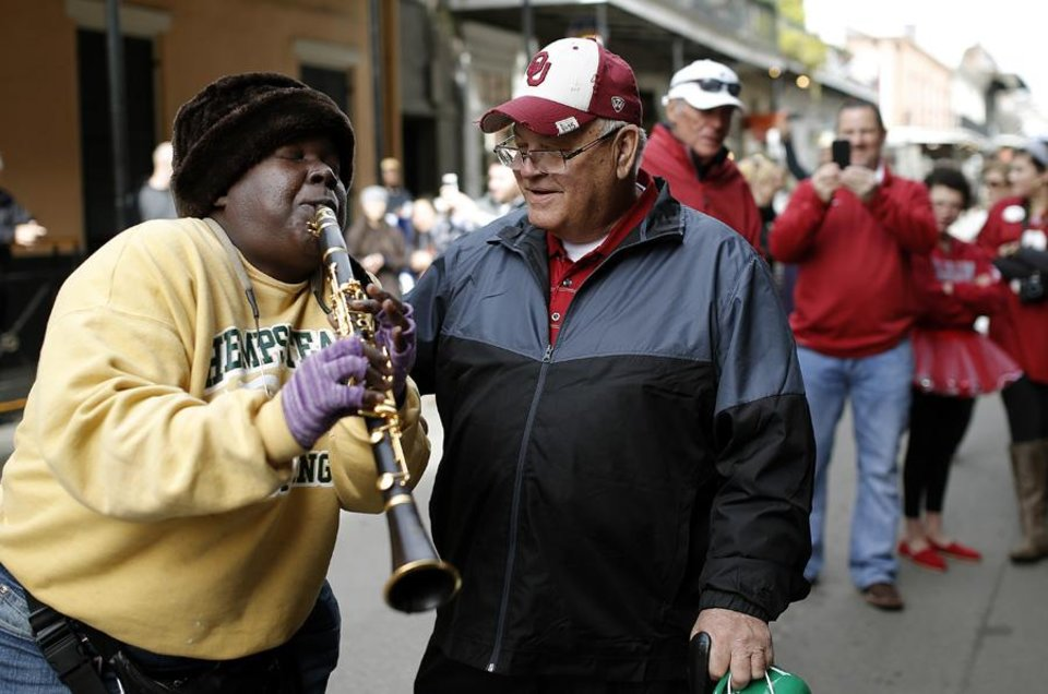 Photo -  Doreen J. Ketchens with the Doreen's Jazz plays Happy Birthday to Oklahoma fan Jerry Kendall, great uncle to OU player Blake Bell, in the French Quarter, Thursday, Jan. 2, 2014 in New Orleans. Photo by Sarah Phipps, The Oklahoman