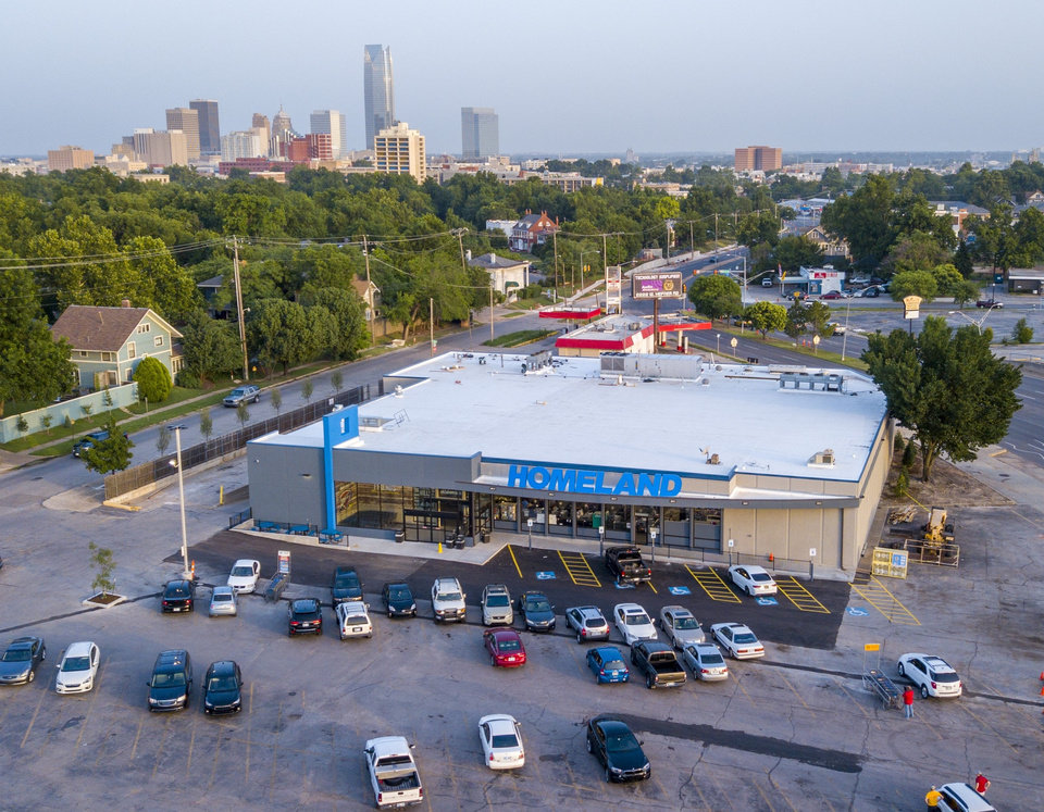 Photo -  The skyline can be seen in the foreground of the only full-service grocery adjacent to downtown and surrounding historic neighborhoods. The current Homeland at 1108 NW 18 dates back to 1974 and underwent the first top-to-bottom makeover that includes new grocery choices, a full-service deli, bakery and meats and seafood counter, and grab-and-go meals. The grand reopening is on Wednesday. [Photo by David Morris, The Oklahoman]