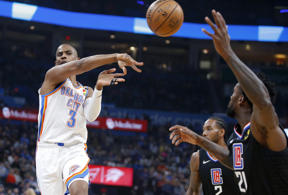 Photo - Oklahoma City's Chris Paul (3) passes the ball during an NBA basketball game between the Oklahoma City Thunder and the Los Angeles Clippers at Chesapeake Energy Arena in Oklahoma City, Tuesday, March 3, 2020. [Bryan Terry/The Oklahoman]
