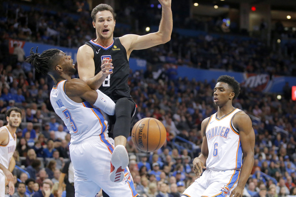 Photo - Danilo Gallinari (8) of the Los Angeles Clippers loses control of the ball between Oklahoma City Thunder's Nerlens Noel (3) and Hamidou Diallo (6) during an NBA basketball game between the Oklahoma City Thunder and the Los Angeles Clippers at Chesapeake Energy Arena in Oklahoma City, Saturday, Dec. 15, 2018. Oklahoma City won 110-104. Photo by Bryan Terry, The Oklahoman
