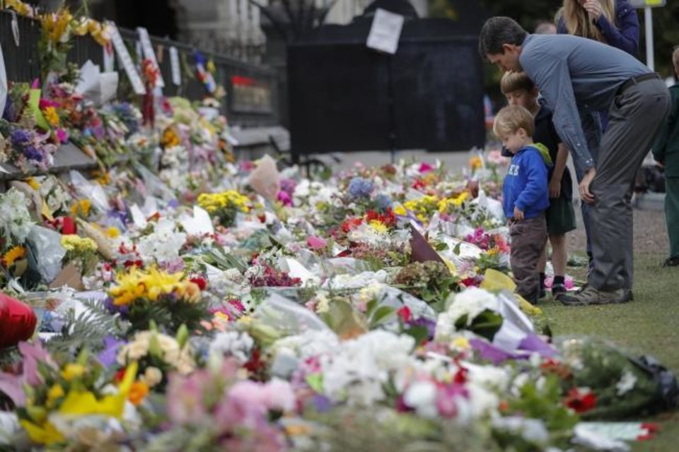 Photo -  In this March 2019 photo, mourners lay flowers on a wall at the Botanical Gardens in Christchurch, New Zealand.  An Australian white supremacist was charged with killing 51 worshippers at two mosques in Christchurch. [AP File Photo]