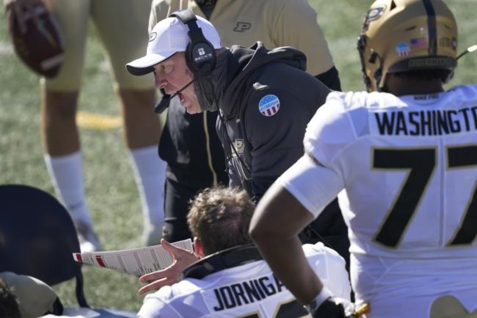 Photo -  Purdue head coach Jeff Brohm yells at his offensive linemen Saturday in a 31-24 win at Illinois. Brohm missed the opener at Iowa due to a positive COVID-19 test. [AP Photo/Charles Rex Arbogast]