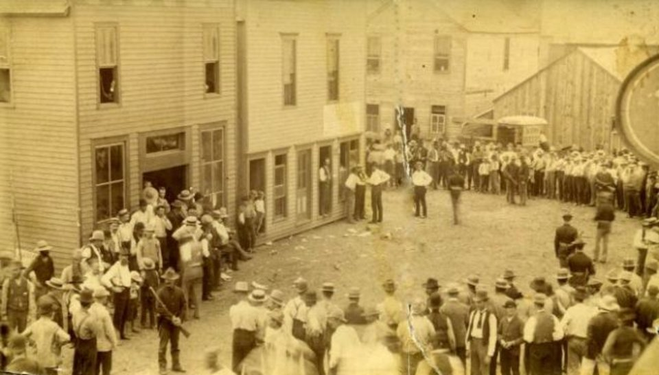 Photo -  A large crowd gathers outside the U.S. Land Commissioner's Office in Purcell, Indian Territory, for the 1889 Land Run. [C. Isa W. Child Collection, OHS]