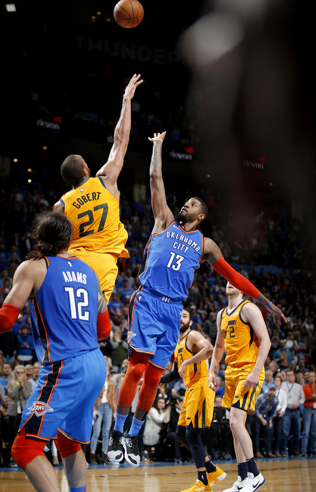 Photo - Oklahoma City's Paul George (13) shoots the go ahead basket in double overtime over Utah's Rudy Gobert (27) during the NBA game between the Oklahoma City Thunder and the Utah Jazz at the Chesapeake Energy Arena, Friday, Feb. 22, 2019. Photo by Sarah Phipps, The Oklahoman