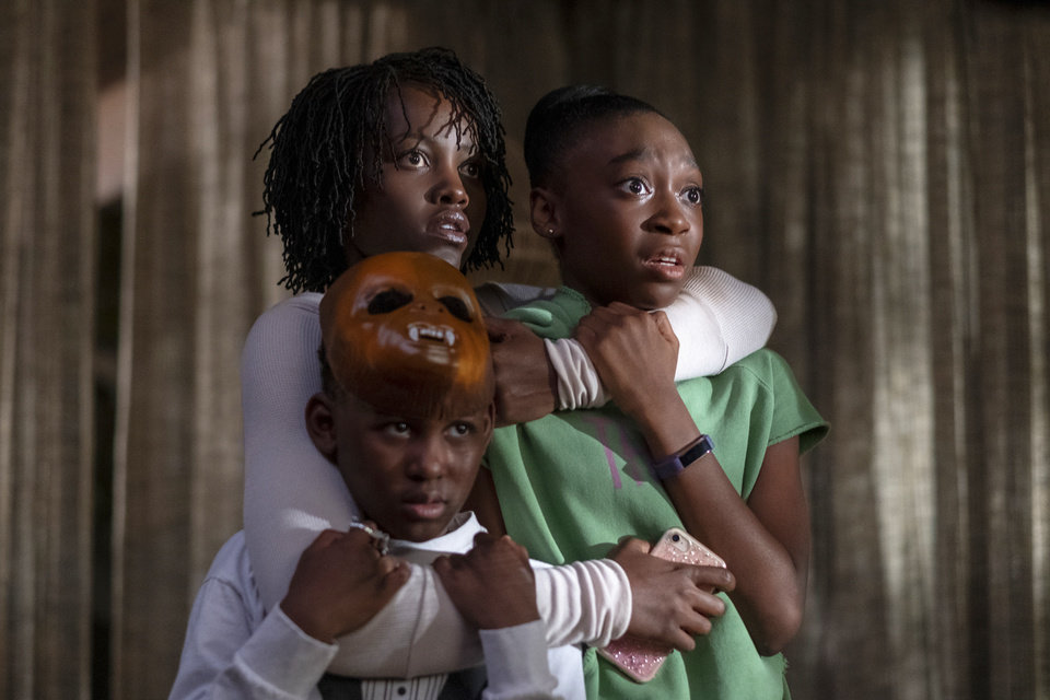 Photo -  This image released by Universal Pictures shows, from left, Evan Alex, Lupita Nyong'o and Shahadi Wright Joseph in a scene from