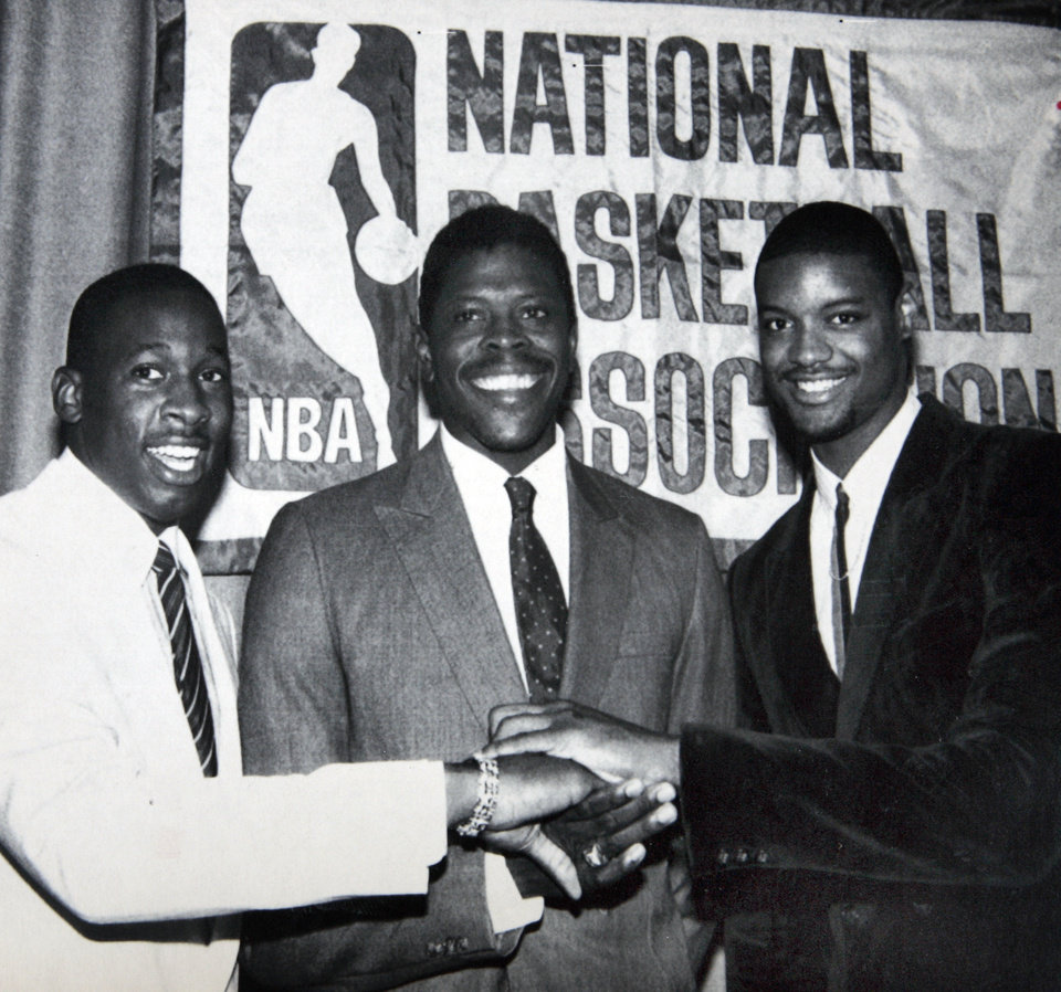 Photo - Former OU basketball player Wayman Tisdale. NEW YORK, June 18--WHY ARE THESE MEN SMILING?--The first three picks of the 1985 National Basketball Association draft congratulate each other Tuesday at the Felt Forum of Madison Square Garden. The Knicks had the first pick of Patrick Ewing of Georgetown University, center, while second choice went to the Indiana Pacers who picked Wayman Tisdale from Oklahoma, left, and the third pick, by the Los Angeles Clippers, was Benoit Benjamin from Creighton University in Nebraska. (AP LaserPhoto) stf-Marty Lederhandler  Photo taken 6/18/1985, published 6/19/1985 in The Daily Oklahoman. ORG XMIT: KOD