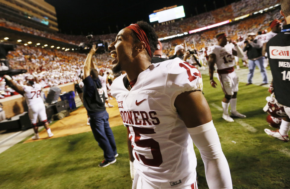 Photo - Oklahoma's Zack Sanchez (15) celebrates after the college football game between the Oklahoma Sooners (OU) and the Tennessee Volunteers at Neyland Stadium in Knoxville, Tennessee, Saturday, Sept. 12, 2015. OU won 31-24 in double overtime. Sanchez intercepted a Tennessee pass in double overtime to end the game. Photo by Nate Billings, The Oklahoman
