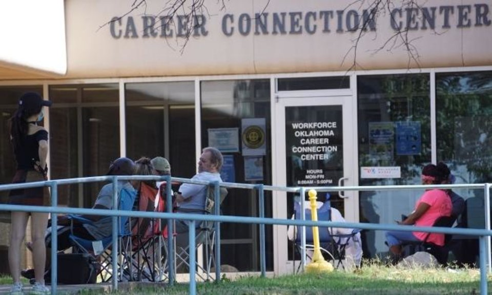 Photo -  People, some who arrived before dawn, waited in line Wednesday outside the Workforce Oklahoma Career Connection Center in eastern Oklahoma County with hopes of getting a walk-in appointment to resolve issues with their unemployment payments. [Ellie Melero/The Oklahoman]