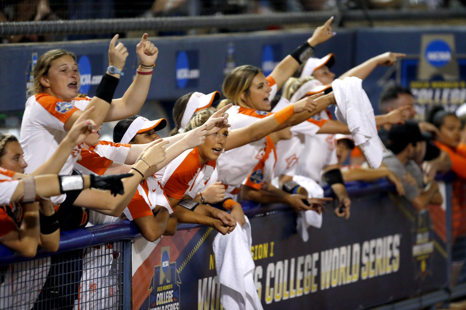 Photo - The Oklahoma State bench cheers during a Women's College World Series between Oklahoma State (OSU) and Oklahoma at USA Softball Hall of Fame Stadium in Oklahoma City,  Friday, May 31, 2019.  [Sarah Phipps/The Oklahoman]