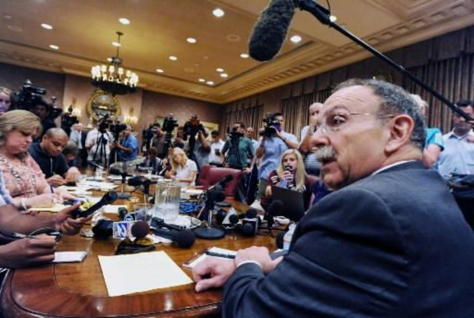 Photo -  Texas A&M president R. Bowen Loftin addresses members of state and national media in the A&M Board of Regents room in College Station Texas Monday, August 15, 2011. Loftin notified the Big 12 Wednesday that A&M is leaving the conference.. ( AP Photo/Bryan-College Station Eagle, Dave McDermand,)