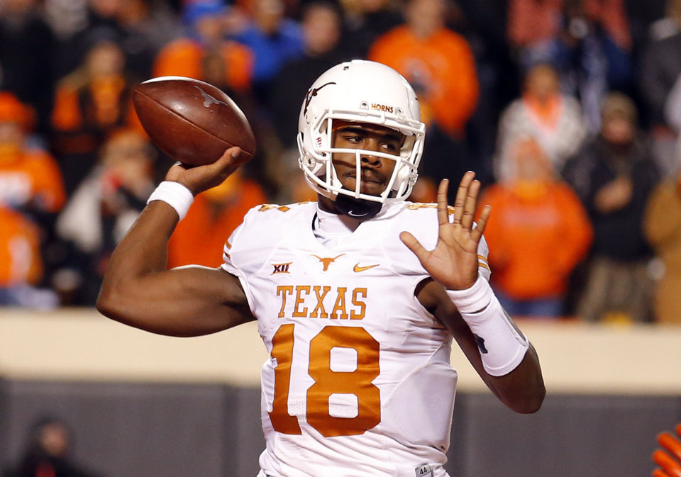 Photo - Texas Tyrone Swoopes (18) looks to throw a pass during the college football game between the Oklahoma State University Cowboys (OSU) the University of Texas Longhorns (UT) at Boone Pickens Staduim in Stillwater, Okla. on Saturday, Nov. 15, 2014.  Photo by Sarah Phipps, The Oklahoman