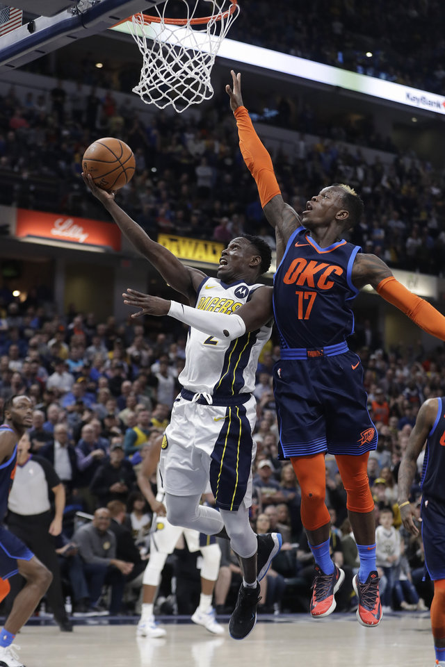 Photo - Indiana Pacers' Darren Collison (2) puts up a shot against Oklahoma City Thunder's Dennis Schroder (17) during the second half of an NBA basketball game, Thursday, March 14, 2019, in Indianapolis. Indiana won 108-106. (AP Photo/Darron Cummings)