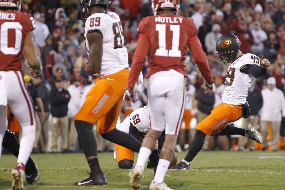 Photo - Oklahoma State's Matt Ammendola (49) misses an extra-point attempt during a Bedlam college football game between the University of Oklahoma Sooners (OU) and the Oklahoma State University Cowboys (OSU) at Gaylord Family-Oklahoma Memorial Stadium in Norman, Okla., Nov. 10, 2018.  Photo by Bryan Terry, The Oklahoman