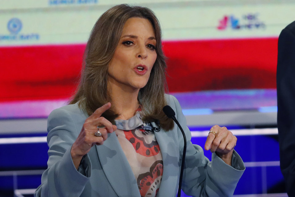 Photo - Democratic presidential candidate author Marianne Williamson speaks during the Democratic primary debate hosted by NBC News at the Adrienne Arsht Center for the Performing Arts, Thursday, June 27, 2019, in Miami. (AP Photo/Wilfredo Lee)