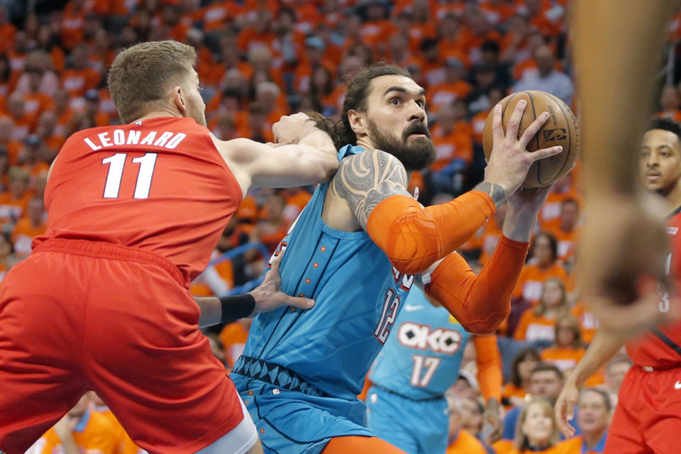 Photo - Oklahoma City's Steven Adams (12) goes past Portland's Meyers Leonard (11) during Game 3 in the first round of the NBA playoffs between the Portland Trail Blazers and the Oklahoma City Thunder at Chesapeake Energy Arena in Oklahoma City, Friday, April 19, 2019. Photo by Bryan Terry, The Oklahoman