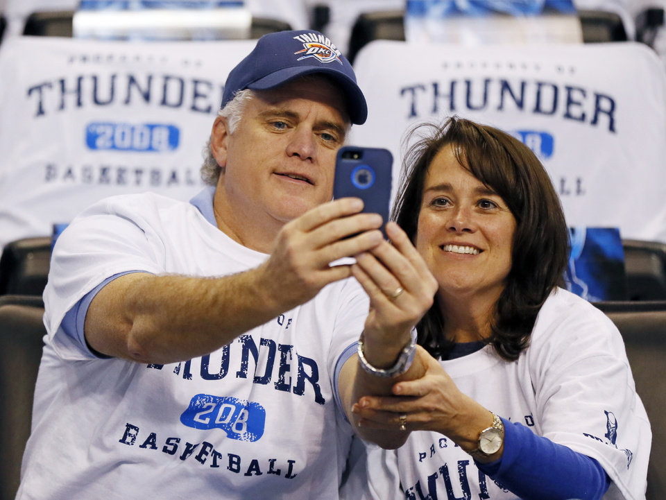 Photo - Randy Kemp and Susan Kemp of Seminole, Okla., take a selfie before Game 4 of the Western Conference semifinals between the Oklahoma City Thunder and the San Antonio Spurs in the NBA playoffs at Chesapeake Energy Arena in Oklahoma City, Sunday, May 8, 2016. Photo by Nate Billings, The Oklahoman