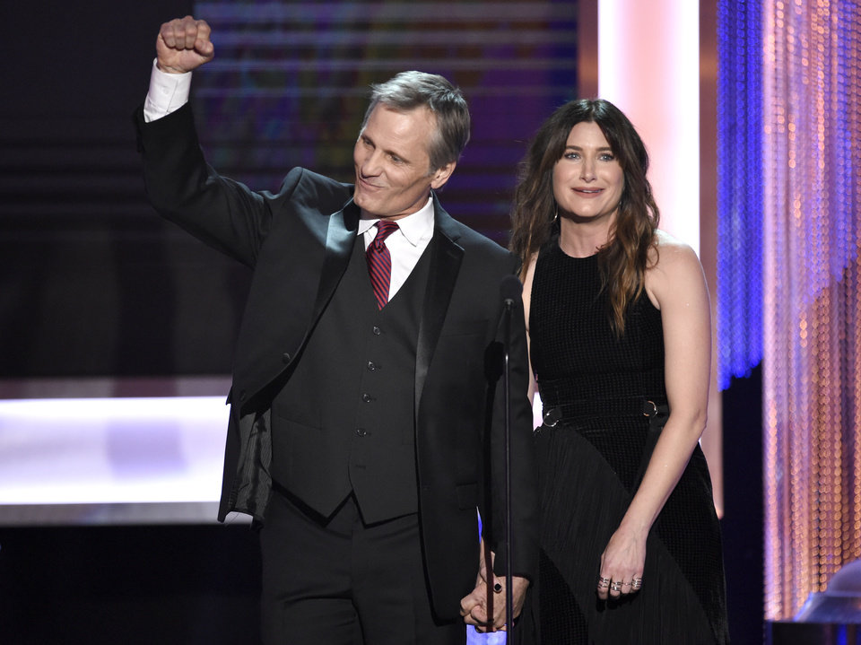 Image result for Actor Viggo Mortensen giving the Marxist raised clenched fist salute to fellow comrades at the 23rd Screen Actors Guild Awards, Janu