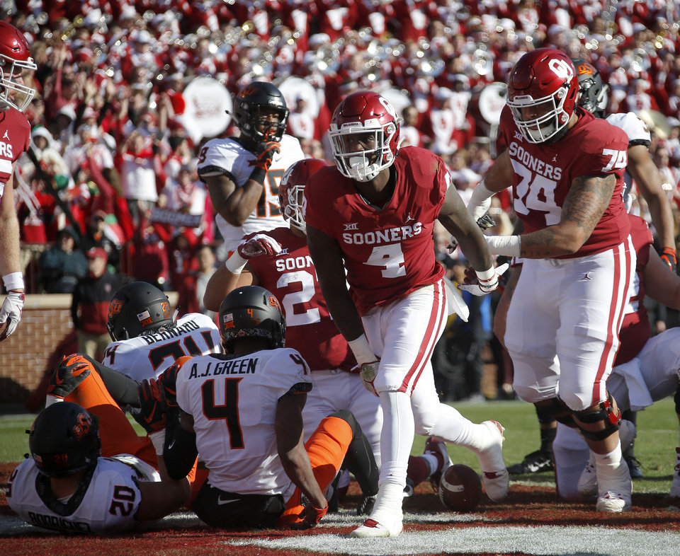 Photo - Oklahoma's Trey Sermon (4) gets up after scoring a touchdown during a Bedlam college football game between the University of Oklahoma Sooners (OU) and the Oklahoma State University Cowboys (OSU) at Gaylord Family-Oklahoma Memorial Stadium in Norman, Okla., Nov. 10, 2018.  Photo by Bryan Terry, The Oklahoman