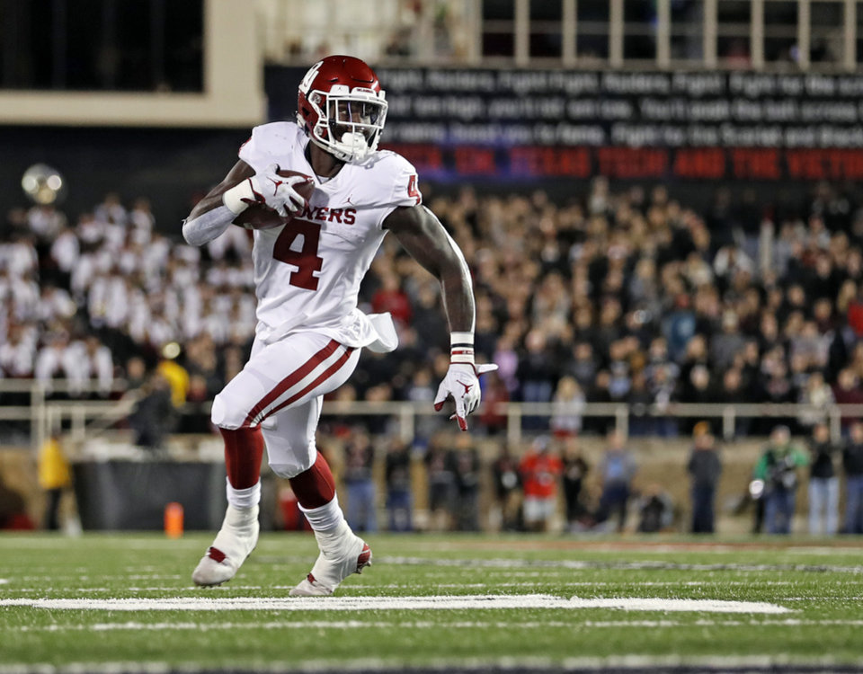 Photo - Oklahoma's Trey Sermon (4) runs downfield with the ball during the first half of an NCAA college football game against Texas Tech, Saturday, Nov. 3, 2018, in Lubbock, Texas. (AP Photo/Brad Tollefson)