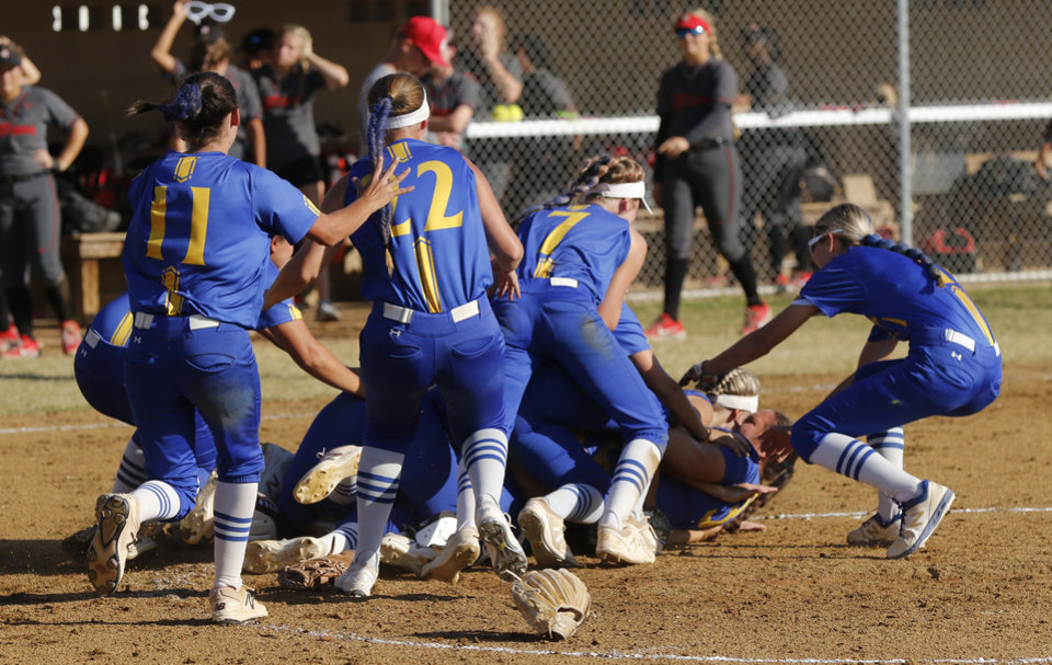 Photo - Piedmont players pile on in the circle after their come from behind win during the 5A Fast Pitch Championship game between Piedmont and Carl Albert at the Ball Fields at Firelake in Shawnee, Saturday, October 19, 2019. [Doug Hoke/The Oklahoman]