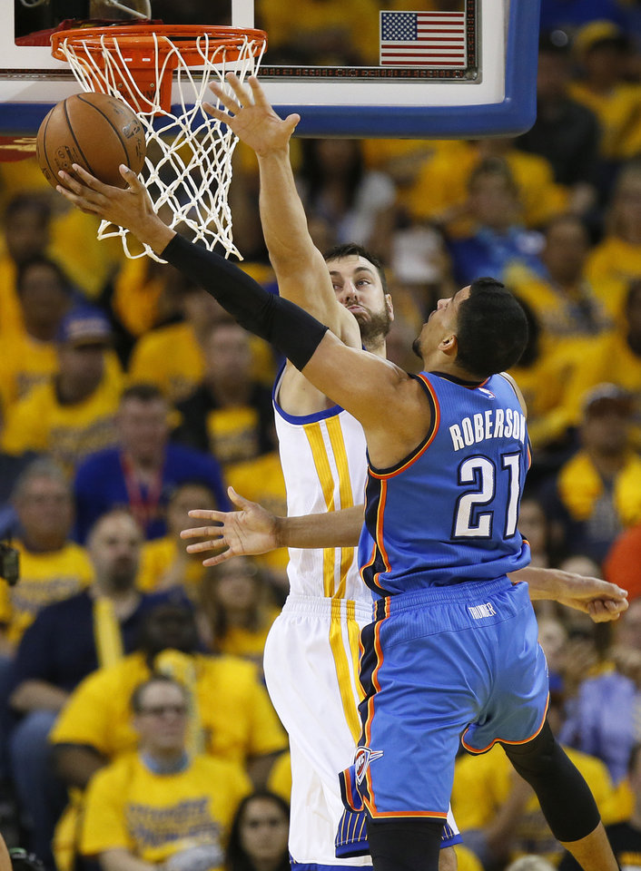 Photo - Oklahoma City's Andre Roberson (21) tries to score against Golden State's Andrew Bogut (12) during Game 2 of the Western Conference finals in the NBA playoffs between the Oklahoma City Thunder and the Golden State Warriors at Oracle Arena in Oakland, Calif., Wednesday, May 18, 2016. Golden State won 118-91. Photo by Nate Billings, The Oklahoman