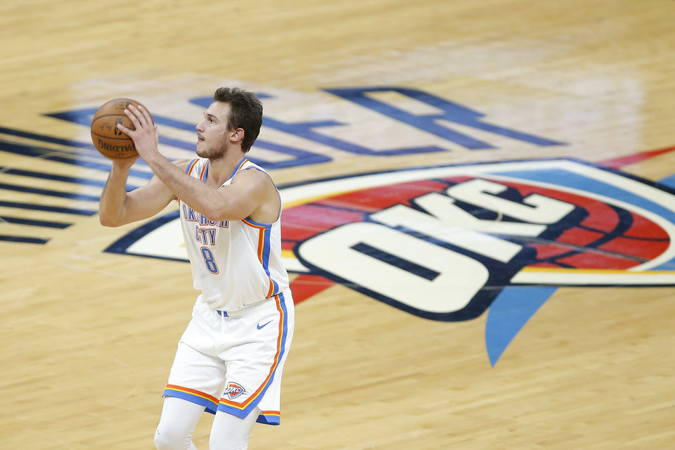 Photo - Oklahoma City's Danilo Gallinari (8) takes a shot during an NBA basketball game between the Oklahoma City Thunder and the Orlando Magic at Chesapeake Energy Arena in Oklahoma City, Tuesday, Nov. 5, 2019. Oklahoma City won 102-94. [Bryan Terry/The Oklahoman]
