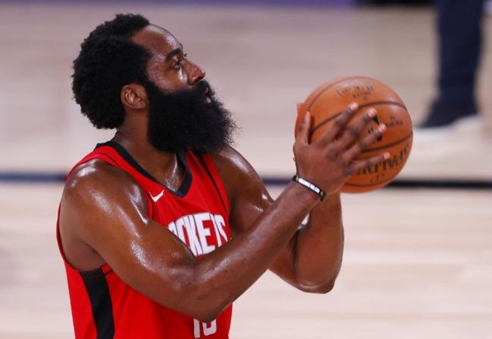 Photo -  Houston guard James Harden led the NBA in scoring for the third consecutive season, averaging 34.3 points per game. [Mike Ehrmann/Pool Photo via USA TODAY Sports]