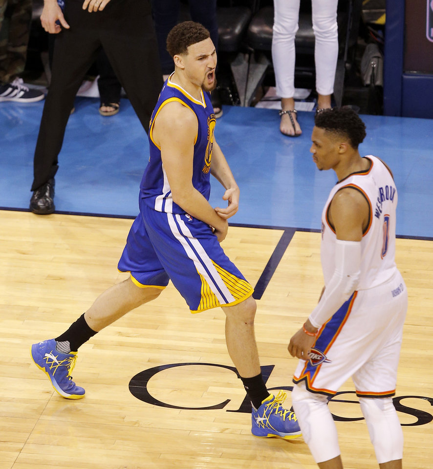 Photo - Golden State's Klay Thompson (11) celebrates next to Oklahoma City's Russell Westbrook (0) after making a 3-pointer late in Game 6 of the Western Conference finals in the NBA playoffs between the Oklahoma City Thunder and the Golden State Warriors at Chesapeake Energy Arena in Oklahoma City, Saturday, May 28, 2016. Photo by Bryan Terry, The Oklahoman