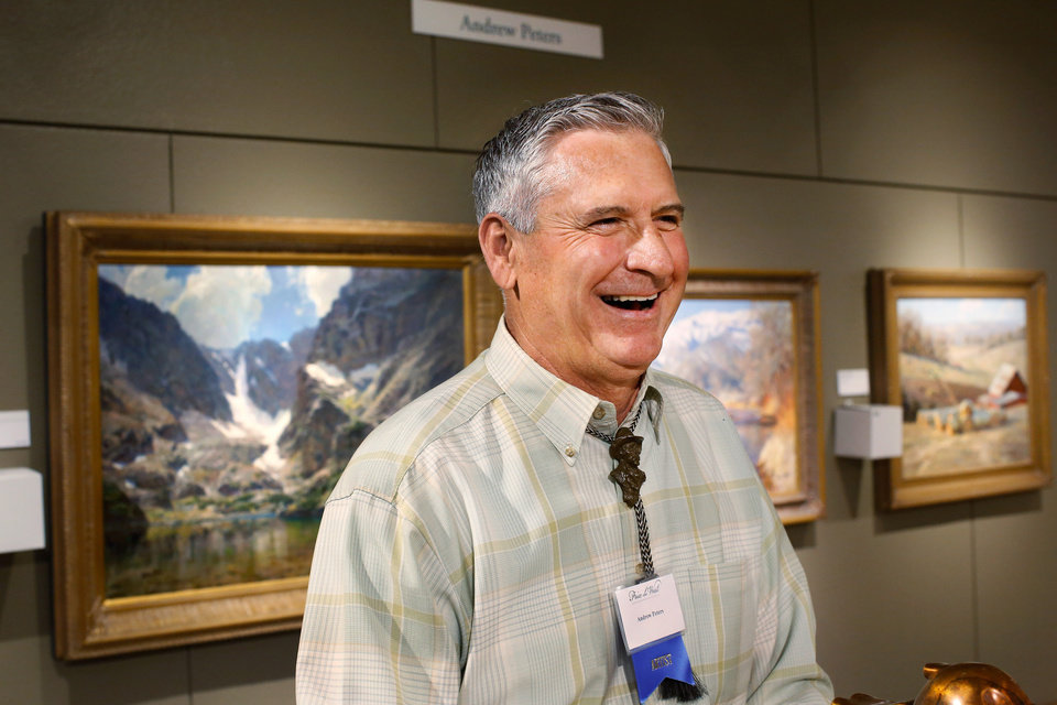 "Photo - Iowa artist Andrew Peters laughs as he as he visits with well-wishers following the announcement that he and his oil painting, ""The Lake of Glass,"" were honored as this year's Prix de West winner at the National Cowboy and Western Heritage Museum on Saturday, June 13, 2015. Peters, 60, from Council Bluffs, used a setting in Rocky Mountain National Park as the inspiration for his 30"" x 40' piece of art. Photo by Jim Beckel, The Oklahoman."