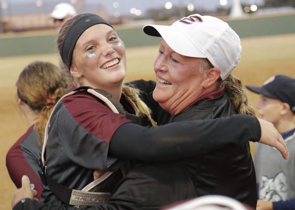 Photo - Edmond coach Janet Chartney hugs catcher Leah McNally during the 6A Fast Pitch Championship game between Edmond Memorial and Owasso at the Ball Fields at Firelake in Shawnee, Saturday, October 19, 2019. [Doug Hoke/The Oklahoman]