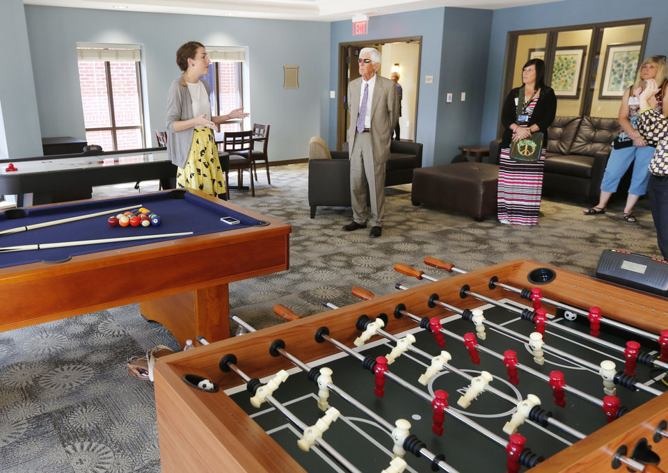 Photo -  Visitors take tours of the new YWCA Thelma Gaylord Emergency Shelter for victims of domestic violence in Oklahoma City, OK, Wednesday, September 2, 2015, Photo by Paul Hellstern, The Oklahoman