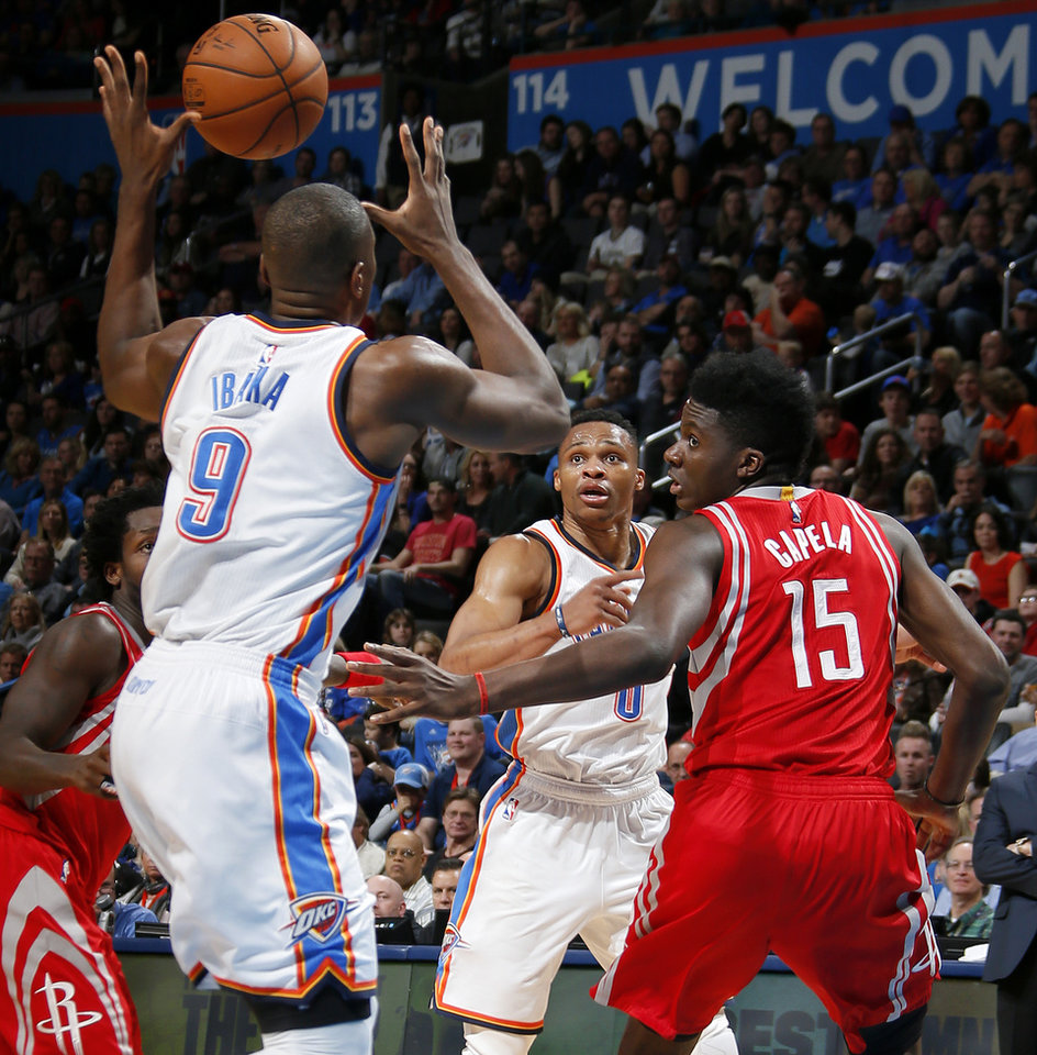 Photo - Oklahoma City's Russell Westbrook (0) passes to Serge Ibaka (9) as Houston's Clint Capela (15) defends during an NBA basketball game between the Oklahoma City Thunder and the Houston Rockets at Chesapeake Energy Arena in Oklahoma City, Friday, Jan. 29, 2016. Oklahoma City won 116-108. Photo by Bryan Terry, The Oklahoman