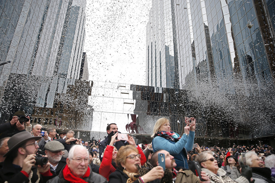 Photo - People celebrate during grand open ceremonies for the Oklahoma City Streetcar system at Leadership Square,  Friday, Dec. 14, 2018. Photo by Sarah Phipps, The Oklahoman