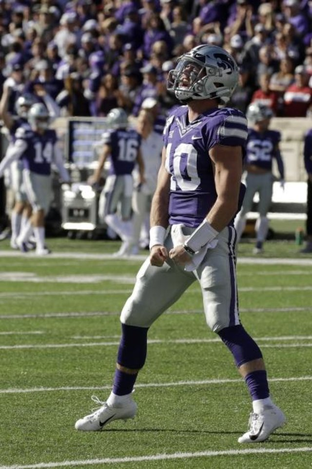 Photo -  Kansas State quarterback Skylar Thompson celebrates during the Wildcats' win over OU on Saturday in Manhattan, Kan. Thompson scored four rushing touchdowns in K-State's win. [AP Photo/Charlie Riedel]