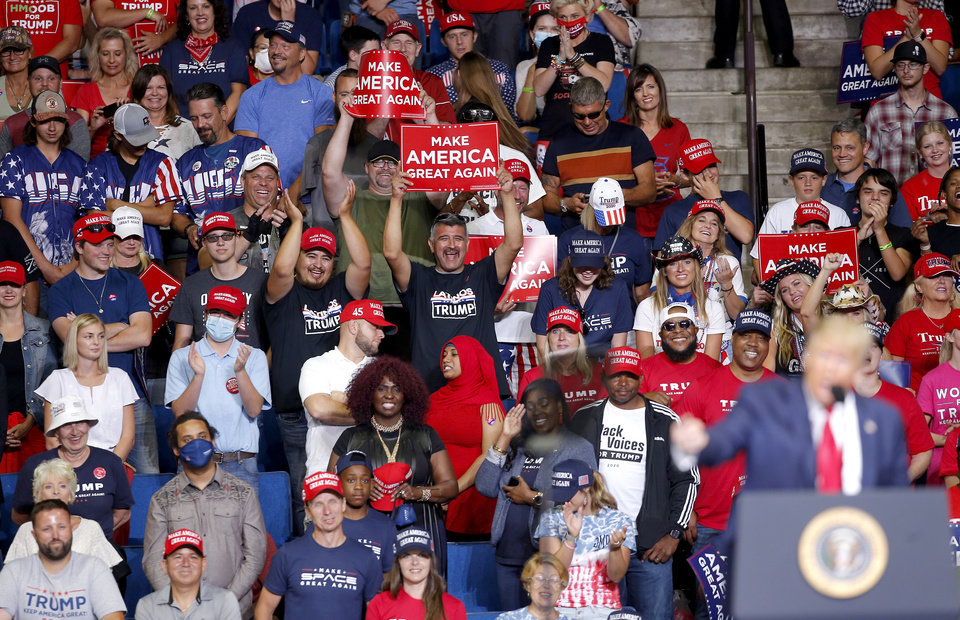 Photo - Crowds listen to President Donald Trump speak during a rally at the BOK Center in Tulsa, Okla., Saturday, June 20, 2020. [Sarah Phipps/The Oklahoman]