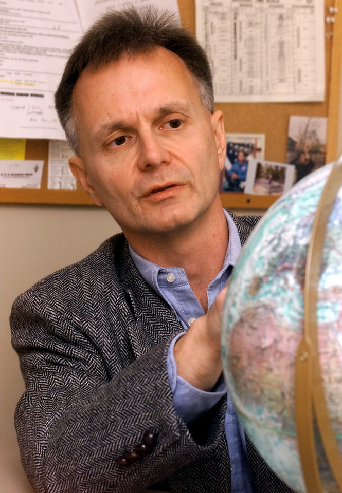 Photo - OU Professor David Deming talks about his theory of how life formed on Earth and where. In his office at the Sarkeys Energy Center. Staff photo by Jaconna Aguirre.