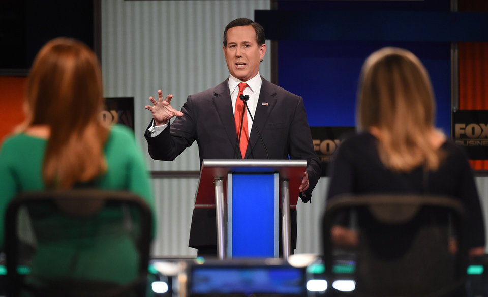 Photo - Republican presidential candidate, former Pennsylvania Sen. Rick Santorum speaks during the Fox Business Network Republican presidential debate at the North Charleston Coliseum, Thursday, Jan. 14, 2016, in North Charleston, S.C. (AP Photo/Rainier Ehrhardt)