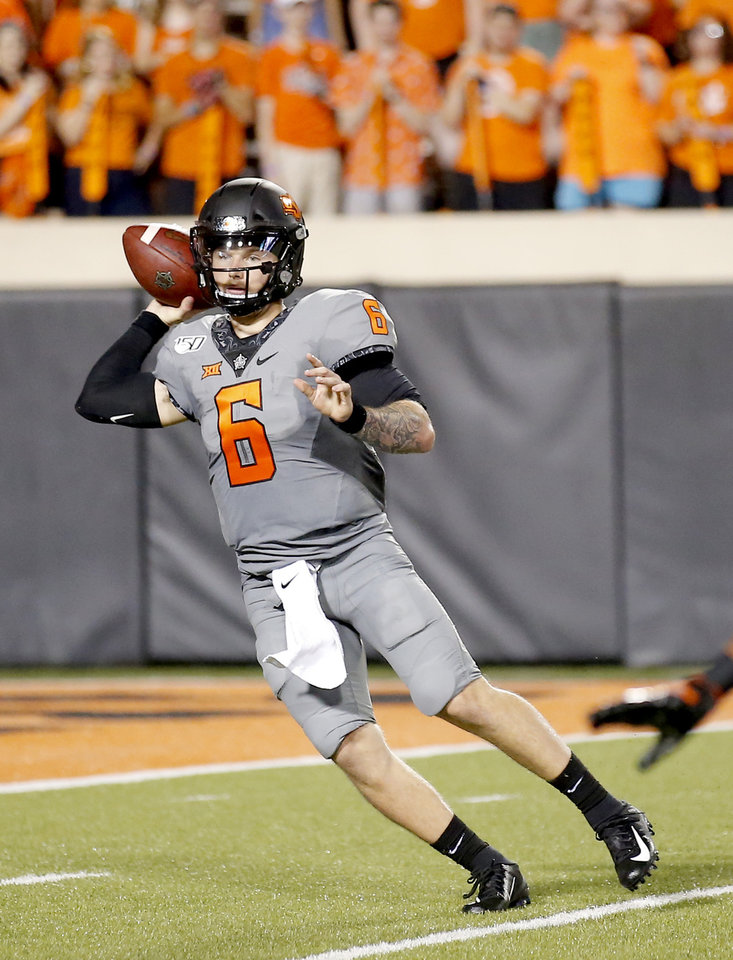 Photo - Oklahoma State's Dru Brown (6) throws a pass in the fourth quarter during the college football game between the Oklahoma State Cowboys and the McNeese State Cowboys at Boone Pickens Stadium in Stillwater, Okla., Saturday, Sept. 7, 2019. [Sarah Phipps/The Oklahoman]
