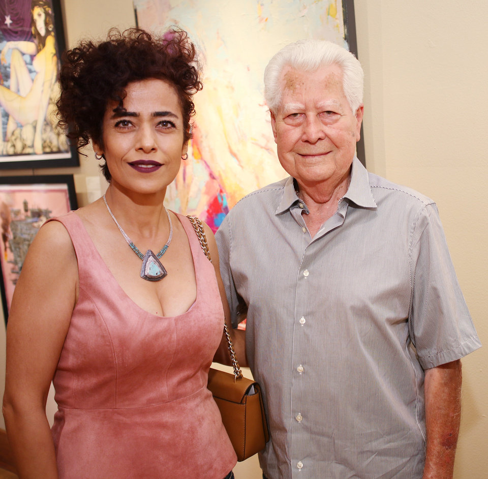 Photo - Behnaz Sohrabian and Bert Seabourn at JRB Art at the Elms gallery during the Paseo First Friday art walk July 7, 2017. Photo by Doug Hoke.