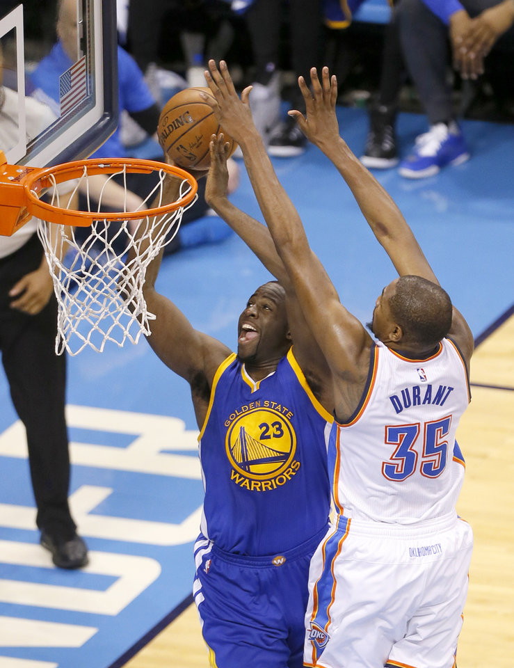 Photo - Oklahoma City's Kevin Durant (35) defends against Golden State 's Draymond Green (23) during Game 3 of the Western Conference finals in the NBA playoffs between the Oklahoma City Thunder and the Golden State Warriors at Chesapeake Energy Arena in Oklahoma City, Sunday, May 22, 2016. Photo by Sarah Phipps, The Oklahoman