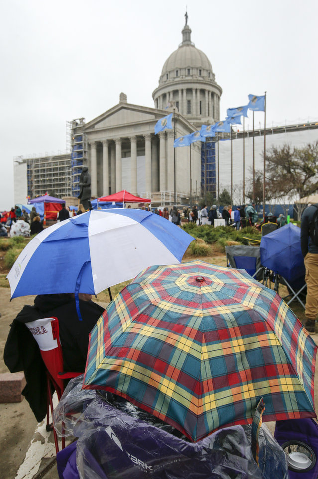 Photo - Teachers and supporters of increased education funding rallied outside the state Capitol despite inclement weather during the fifth day of a walkout by Oklahoma teachers, in Oklahoma City, Friday, April 6, 2018. Photo by Nate Billings, The Oklahoman