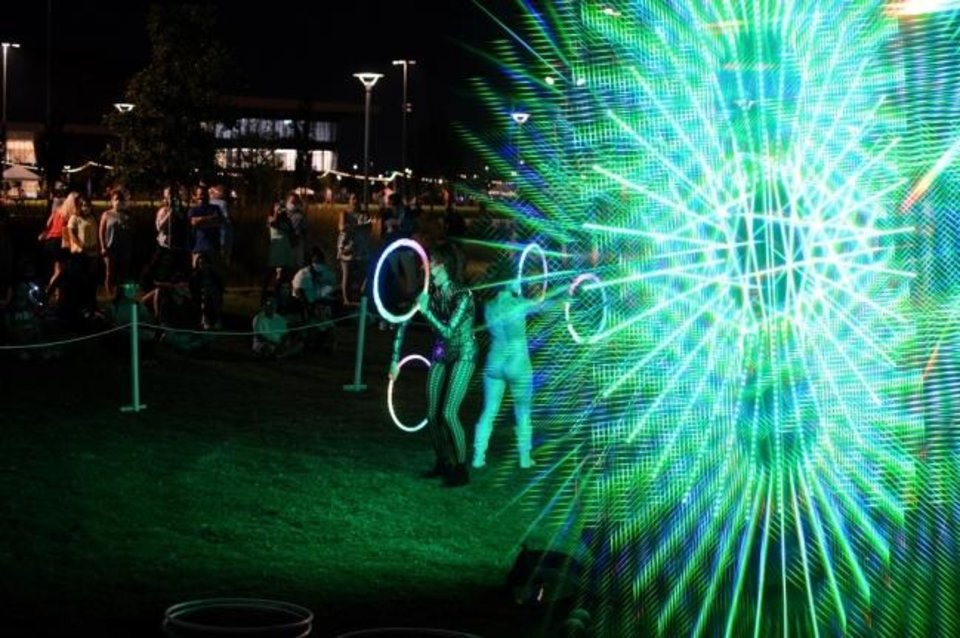 Photo -  Two circus artists perform alongside Factory Obscura's Downtown Starlight Sept. 5 in Kerr Park. [Justin Waits photo]